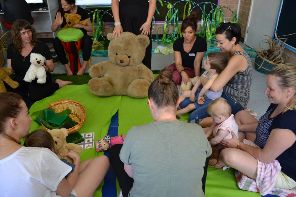 Parents doing activities with groups of babies and toddlers